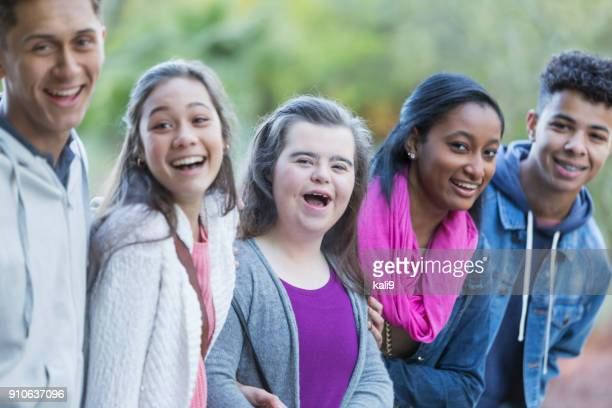 Multi-ethnic friends, teenage girl with down syndrome