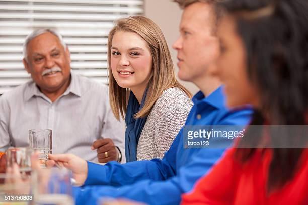 Multi-ethnic, generation family enjoys holiday dinner together.