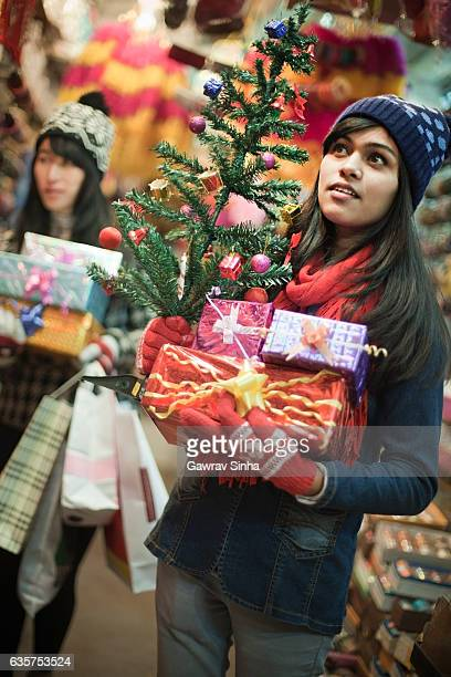 Multiethnic girls in market shopping for Christmas and new year.