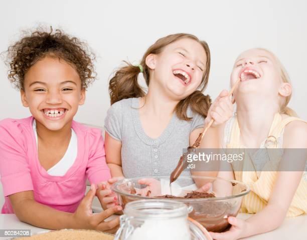 Multi-ethnic girls making batter