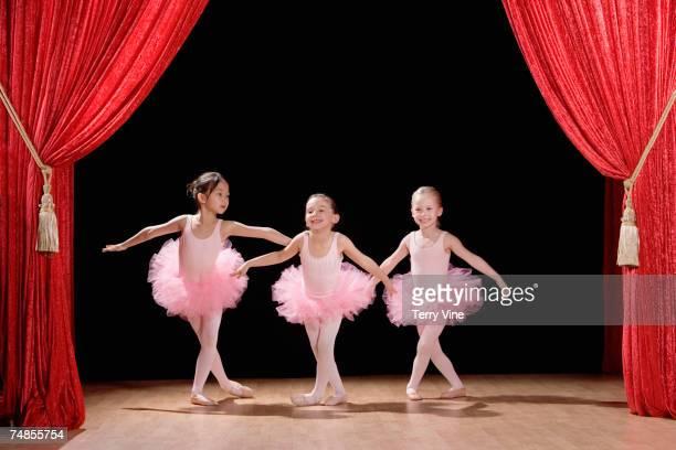 Multi-ethnic girls performing ballet recital