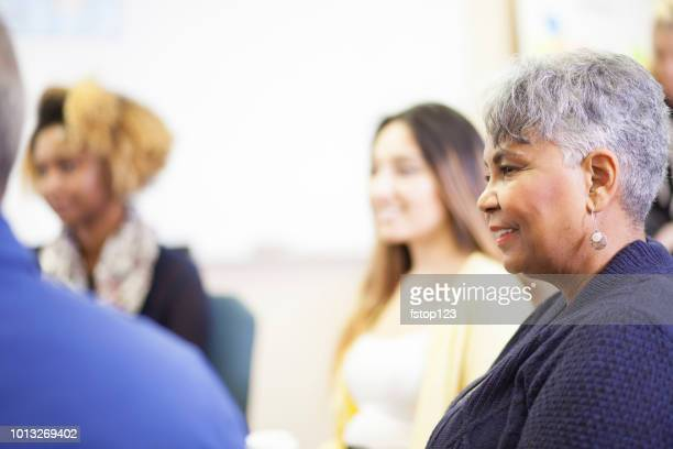 multi-ethnic group counseling session, support meeting. - enslaved stock pictures, royalty-free photos & images