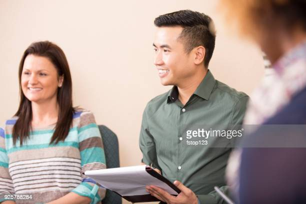 multi-ethnic group counseling session, support meeting. - drug rehab stock pictures, royalty-free photos & images