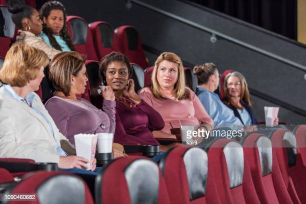 multi-ethnic group in movie theater, mostly women - film screening stock pictures, royalty-free photos & images