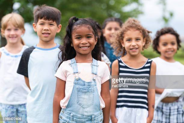 multi-ethnic group of adorable kids posing - children only stock pictures, royalty-free photos & images