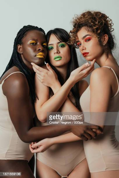 multi-ethnic group of beautiful women posing together in studio - editorial stock pictures, royalty-free photos & images