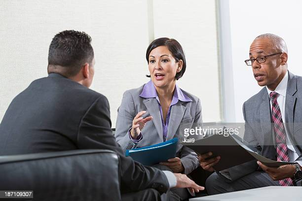 Multi-ethnic group of business executives talking