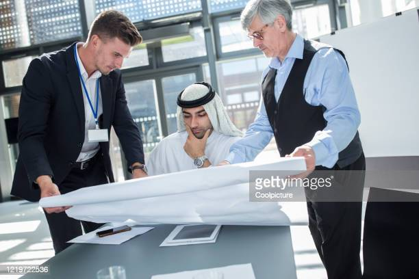 multiethnic group of business people having a meeting. - men's field event stock pictures, royalty-free photos & images