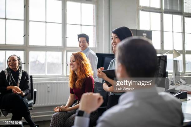 multi-ethnic group of business people having a meeting - five people stock pictures, royalty-free photos & images