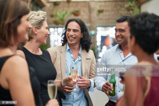 Multi-ethnic group of business people having drinks in a convention