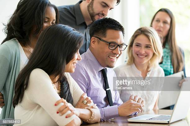 Multi-ethnic group of business professionals are