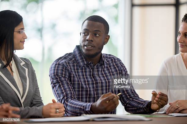 A multi-ethnic group of business professionals are