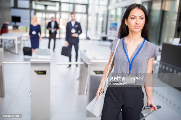 multiethnic group of businesspeople attending a conference - entering stock pictures, royalty-free photos & images