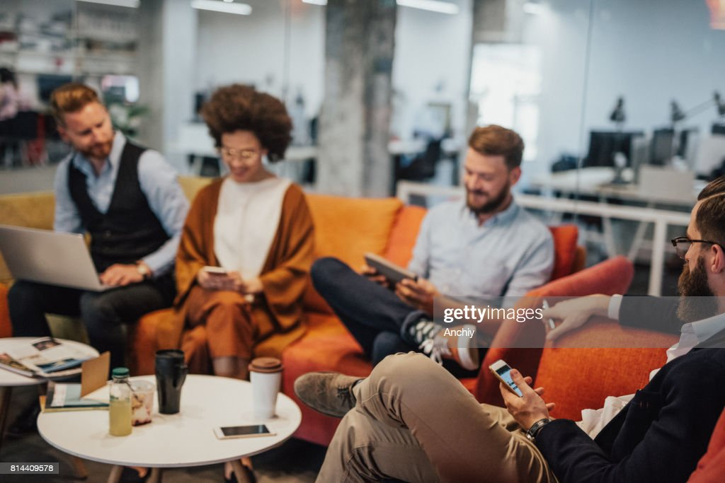 Multi-ethnic group of businesspeople drinking coffee during break : Stock Photo