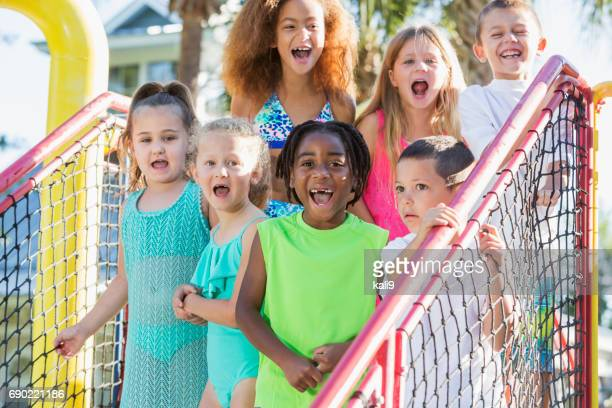 Multi-ethnic group of children at water park