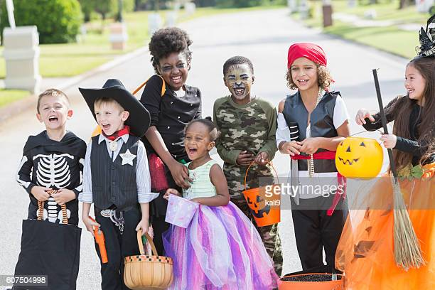 Multi-ethnic group of children in halloween costumes