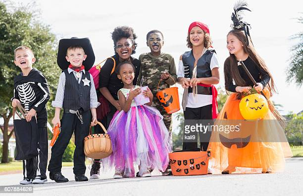 multi-ethnic group of children in halloween costumes - halloween kids stock photos and pictures