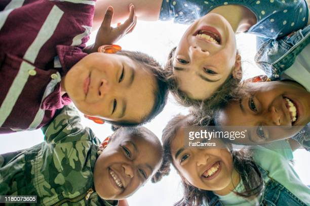 multi-ethnic group of children outside stock photo - childhood stock pictures, royalty-free photos & images