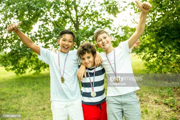multiethnic group of children - medallist stock pictures, royalty-free photos & images