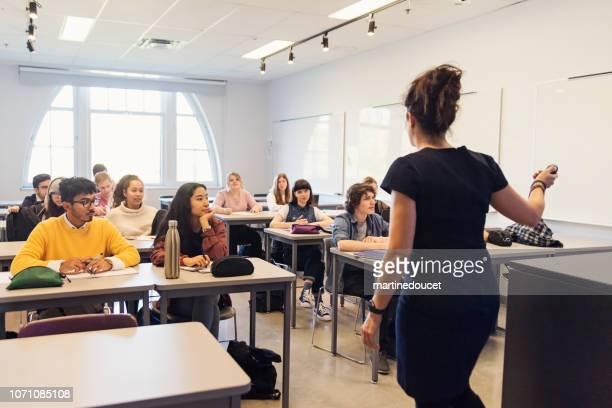 multi-ethnic group of college students in classroom. - istruzione post secondaria foto e immagini stock