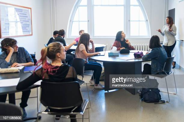 Multi-ethnic group of College students in classroom.