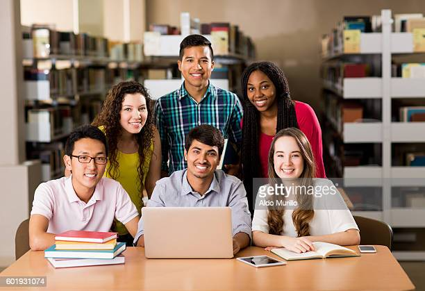 Multi-ethnic group of college students smiling at camera