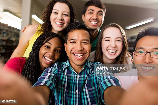 Multi-ethnic group of college students taking a selfie