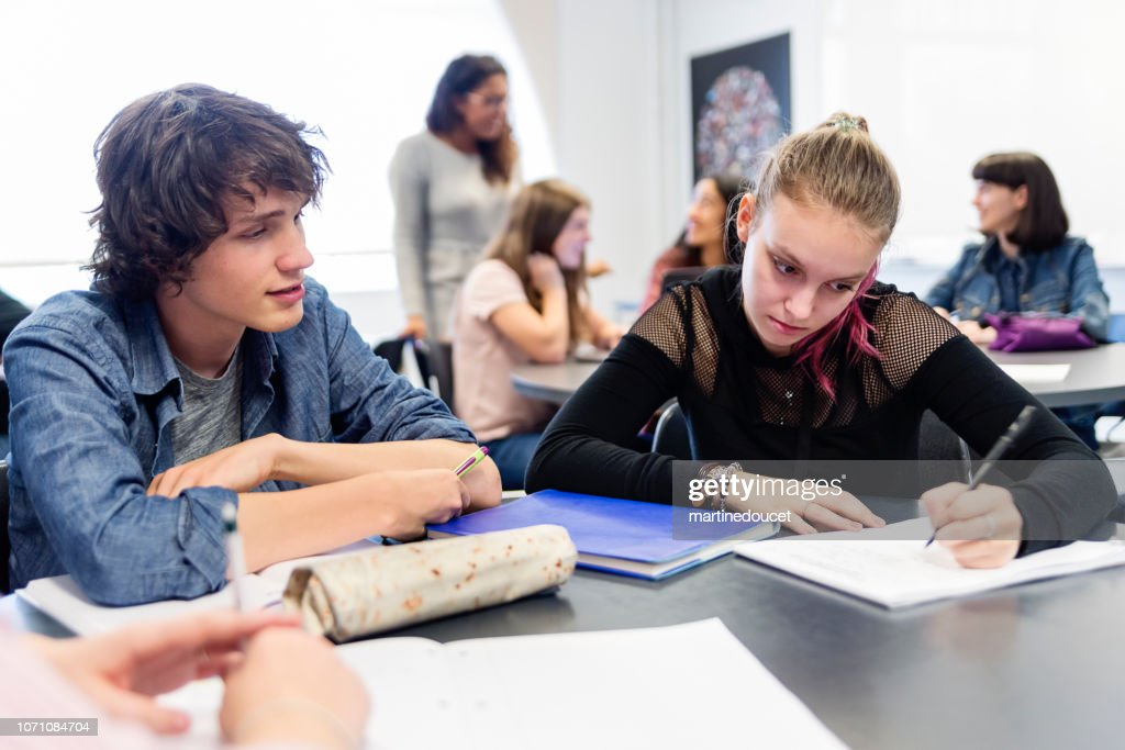 Multi-ethnic group of College students working in team in classroom. : Stock Photo