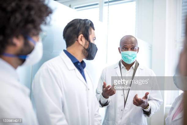 multiethnic group of doctors at the hospital. - healthcare stock pictures, royalty-free photos & images
