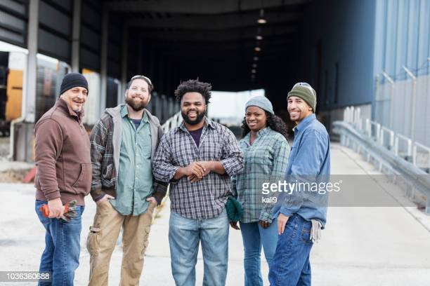 multi-ethnic group of five manual workers - stereotypically working class stock pictures, royalty-free photos & images
