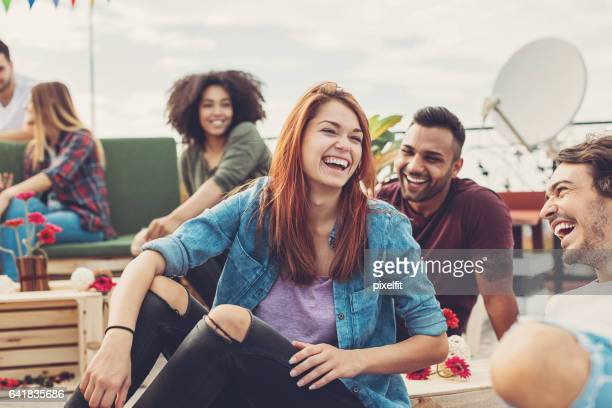 multi-ethnic group of friends chatting and laughing - dyed red hair stock pictures, royalty-free photos & images