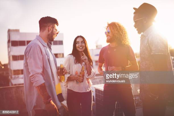 Multi-ethnic group of friends having fun at rooftop party