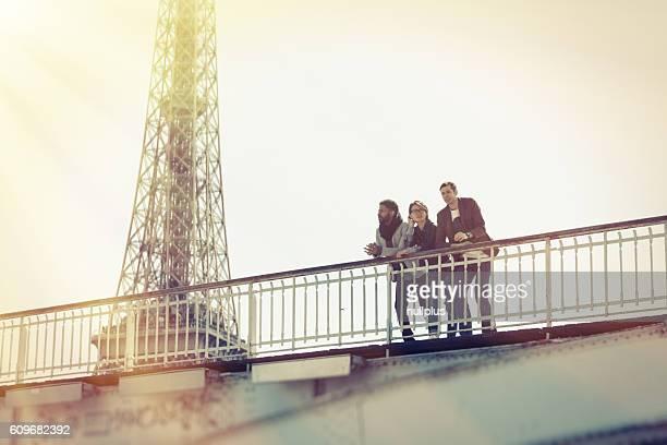 Multi-ethnic group of friends having fun in Paris along Seine