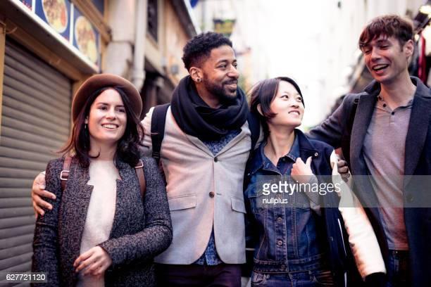 Multi-ethnic group of friends having fun in Paris, Quartier Latin
