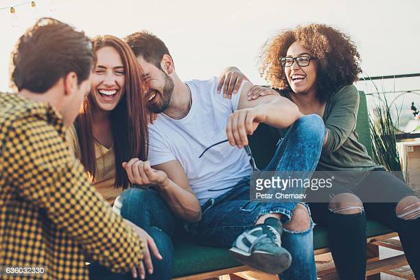 Multi-ethnic group of friends laughing