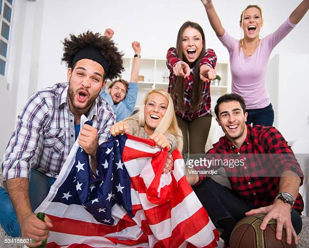 Multiethnic group of friends watching a basketball game