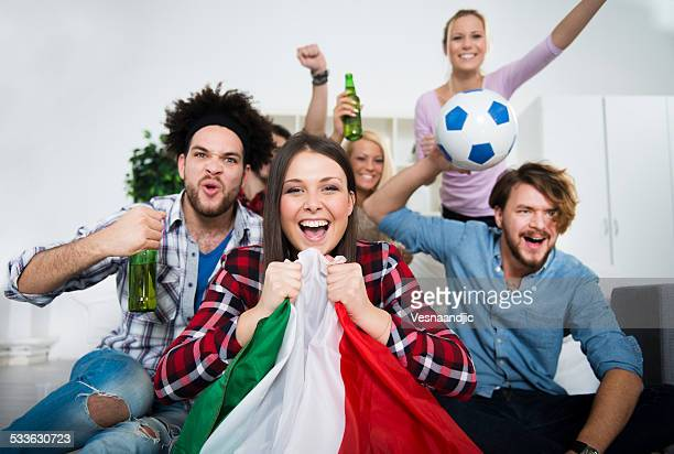 multiethnic group of friends watching a football game - fan enthusiast stock pictures, royalty-free photos & images