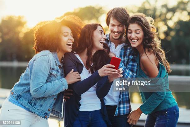 Multi-ethnic group of friends with smart phone