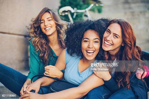 multi-ethnic group of girls laughing - beautiful black teen girl stock photos and pictures