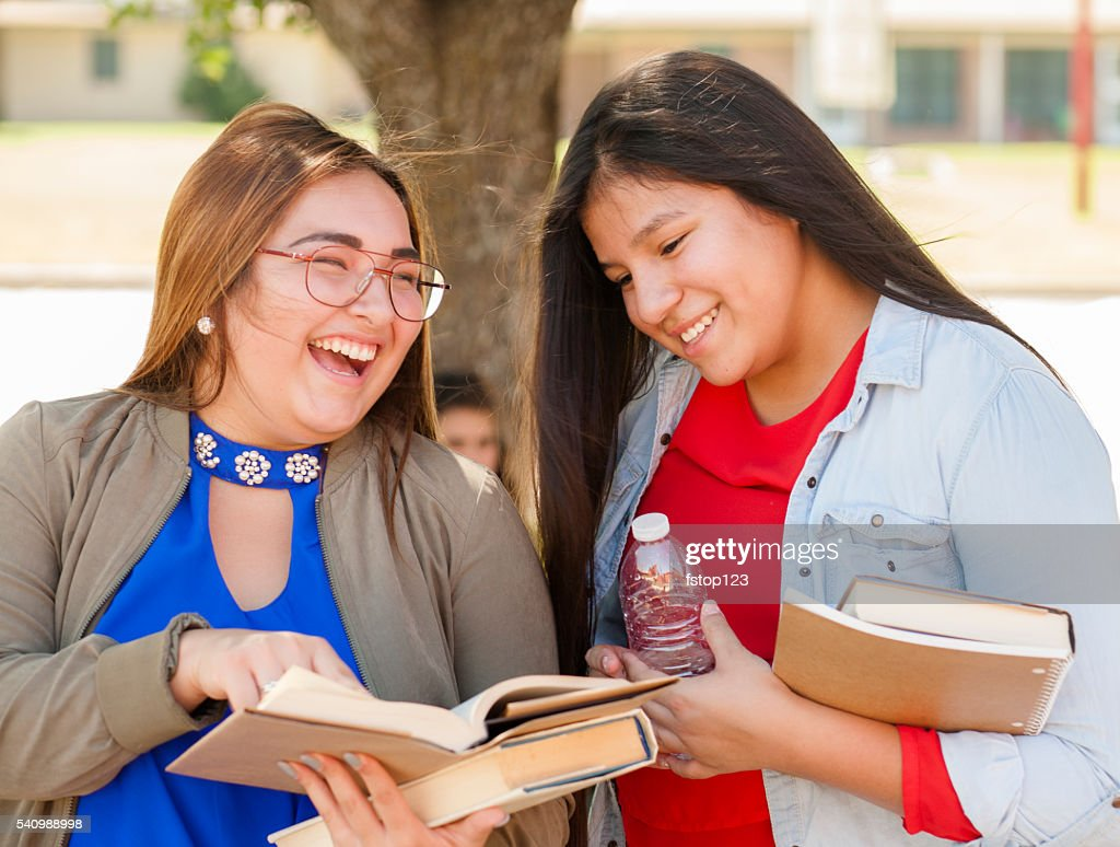 Multi-ethnic group of high school or college girls talking.  Campus. : Stock Photo