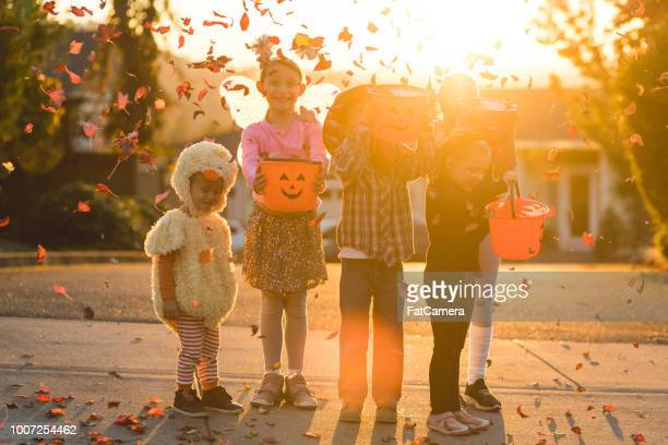 multiethnic group of kids trick or treating - happy halloween stock photos and pictures