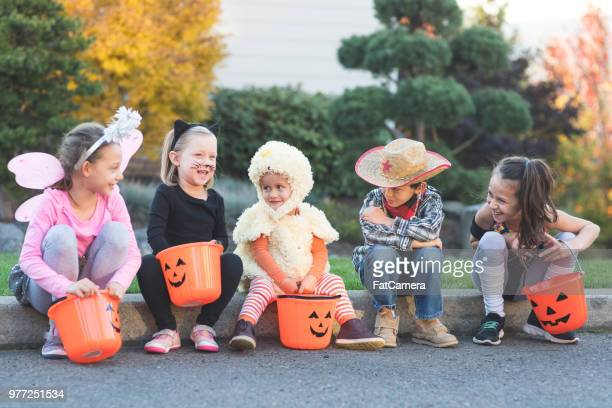 multiethnic group of kids trick or treating - halloween kids stock photos and pictures