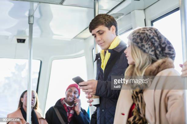 multi-ethnic group of people at rush hour on train - stranger stock photos and pictures