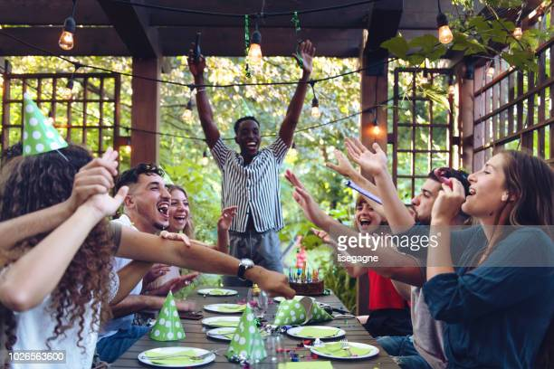 Multi-ethnic group of people celebrating birthday