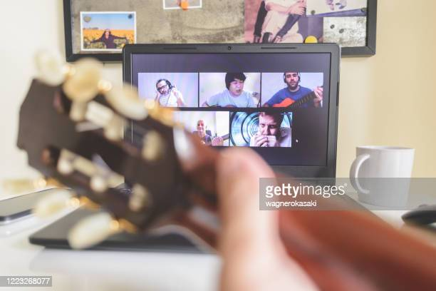 multi-ethnic group of people online playing music together in a video conference - musician stock pictures, royalty-free photos & images