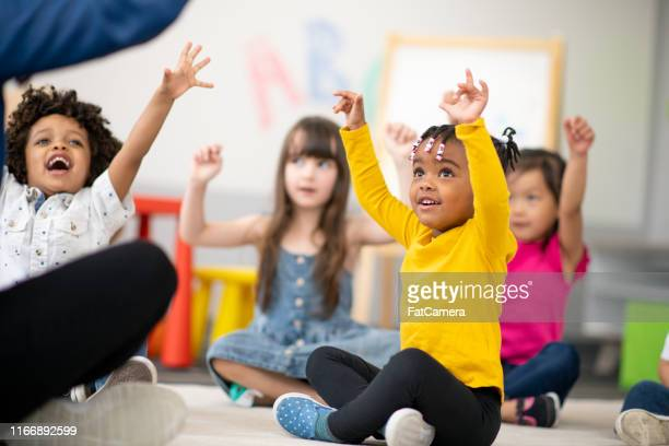 multi-ethnic group of preschool students in class - montessori education stock pictures, royalty-free photos & images