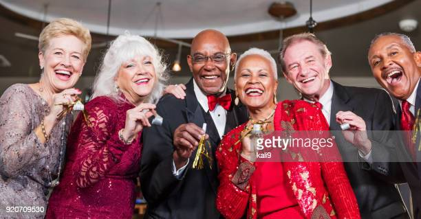 Multi-ethnic group of seniors having party