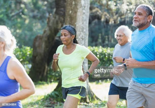 Multi-ethnic group of seniors running in park