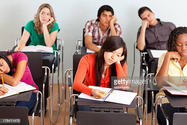Multi-ethnic group of students bored during class