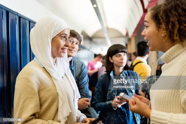 "multi-ethnic group of students hanging in college hall. - ""martine doucet"" or martinedoucet stock pictures, royalty-free photos & images"